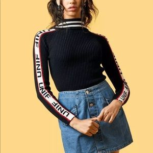 UNIF Badsport Striped Ribbed Mock Neck Sweater